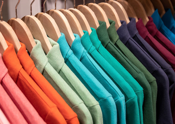 Colorful polo shirt on hang for sale in