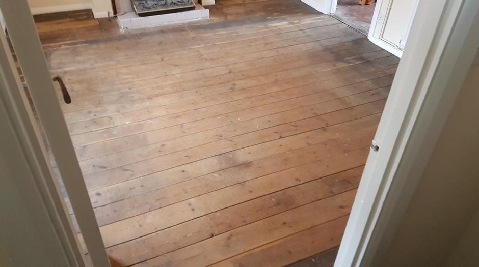 Pine floor boards. before sanding  Hitchin hertfordshire