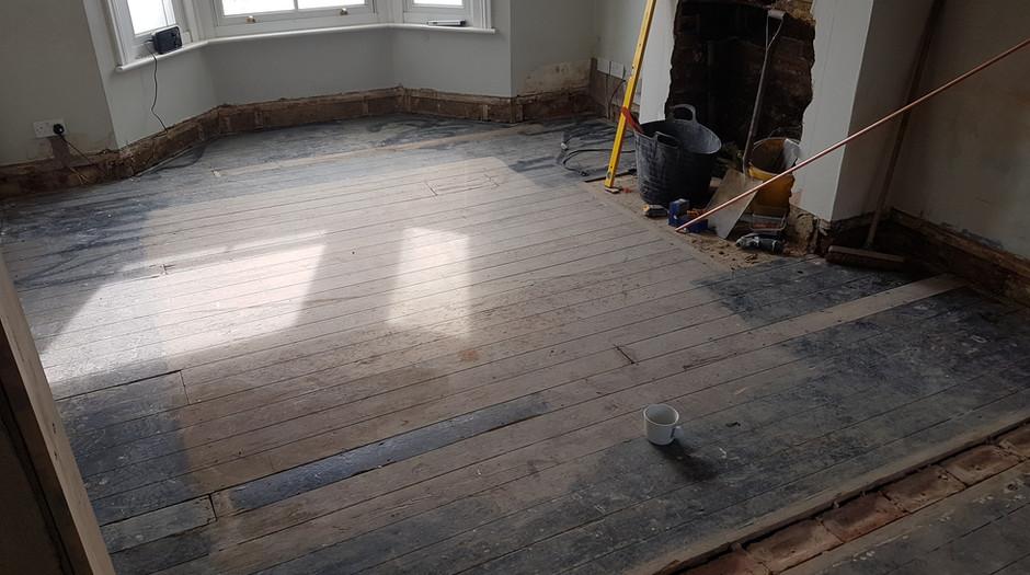 Pine floor boards. Before sanding.