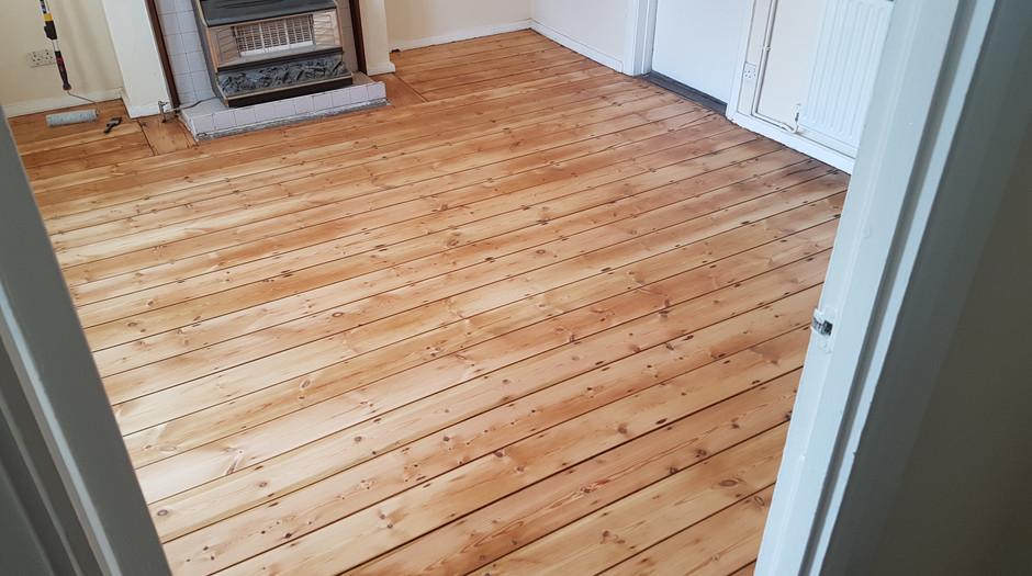 Pine floor boards. After sanding/applying finish Hitchin hertfordshire