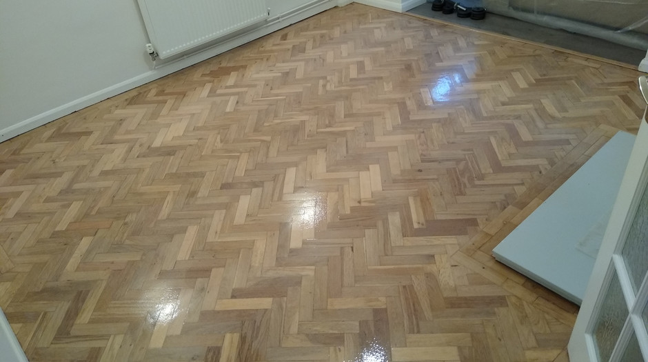 Letchworth Hertfordshire. Parquet sanded and lacquerd with new threshold install.