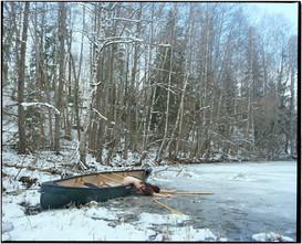 Body in Boat on Frozen Lake