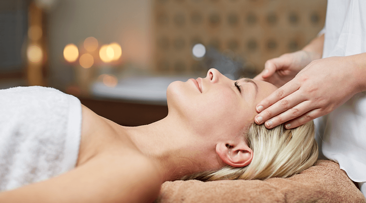 woman-getting-a-face-massage.png