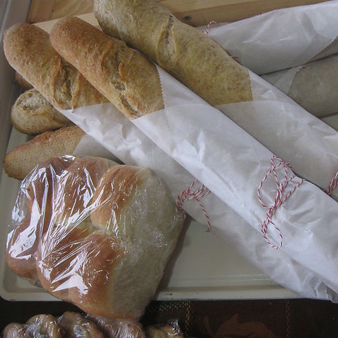 Fresh bread, baguettes, and rolls.