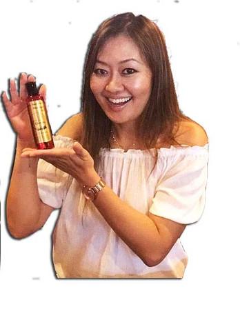 Jennifer hold relax - massage oil.jpg