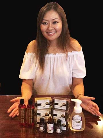 Jennifer with line of products.jpg