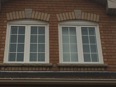 Casement windows with 5/8 white prairie grills