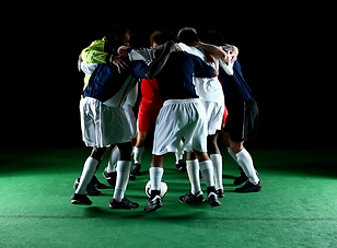 a-group-of-soccer-players-huddle-in-a-ci
