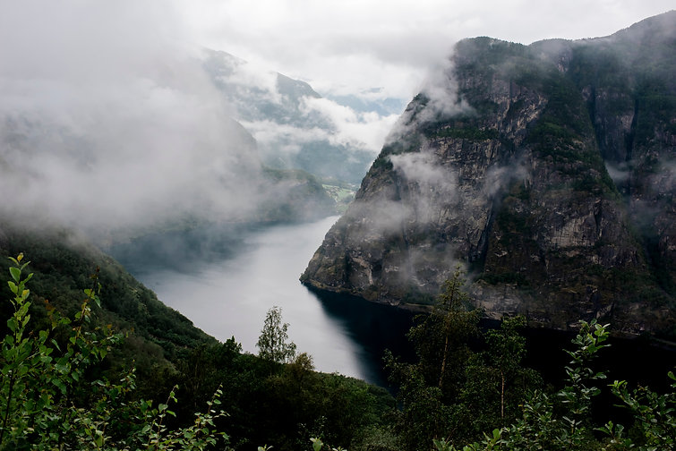 Overhead view of Stunning Norwegian Fjord covered in mist in Norway.jpg