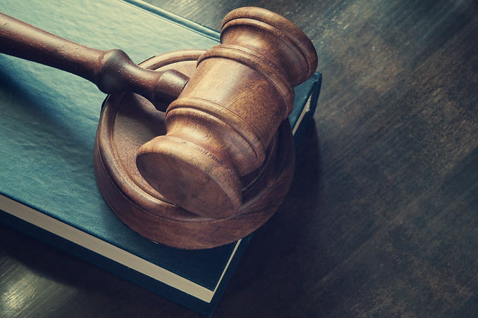 Judge gavel and legal book on wooden tab