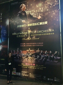 Standing in front of Poster on China tour advertisement