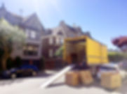 open moving truck with loading ramp and boxes