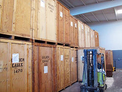 wooden storage vaults inside a warehouse