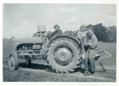 Joy on Grey Ferguson tractor with sister
