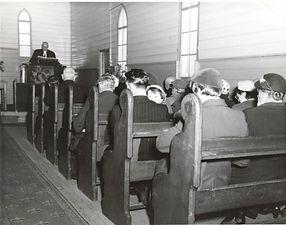 Rev JJ Scott at the poulpit inside old c