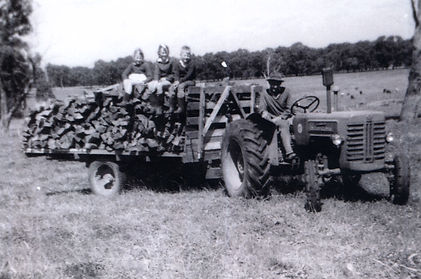 charlie thomson on tractor and 3 kids mi