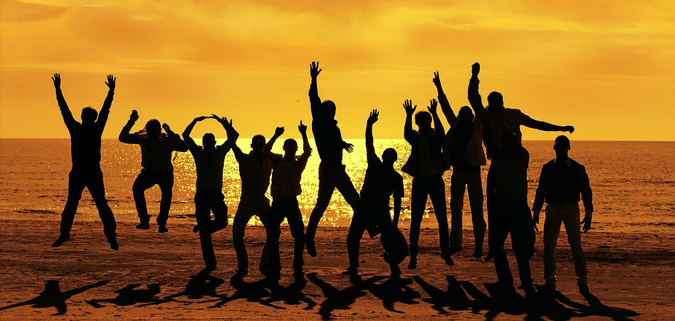 Friends jumping the beach