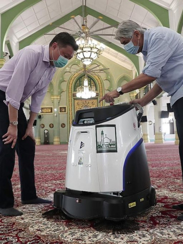 Robots help clean the Sultan Mosque.jpg