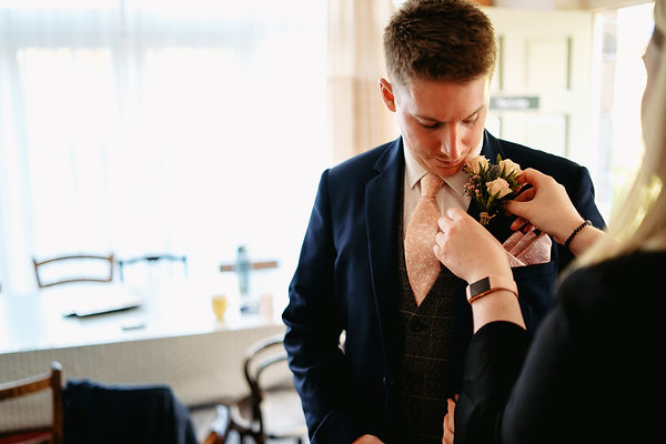 Helping the groom get ready on the morning of his wedding day. UK wedding planning, wedding planner Yorkshire & Derbyshire