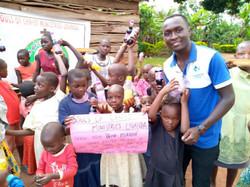 Ggita with the kids celebrating Easter 2021 in Uganda.
