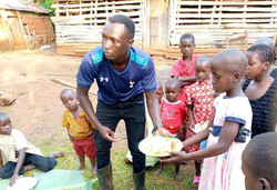 Ggita hands out plates of food during Easter 2021celebration.