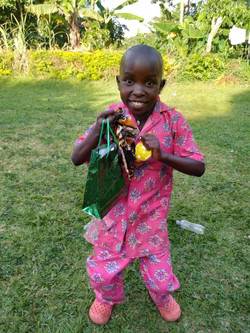 One of our angels showing off his Christmas goodies.