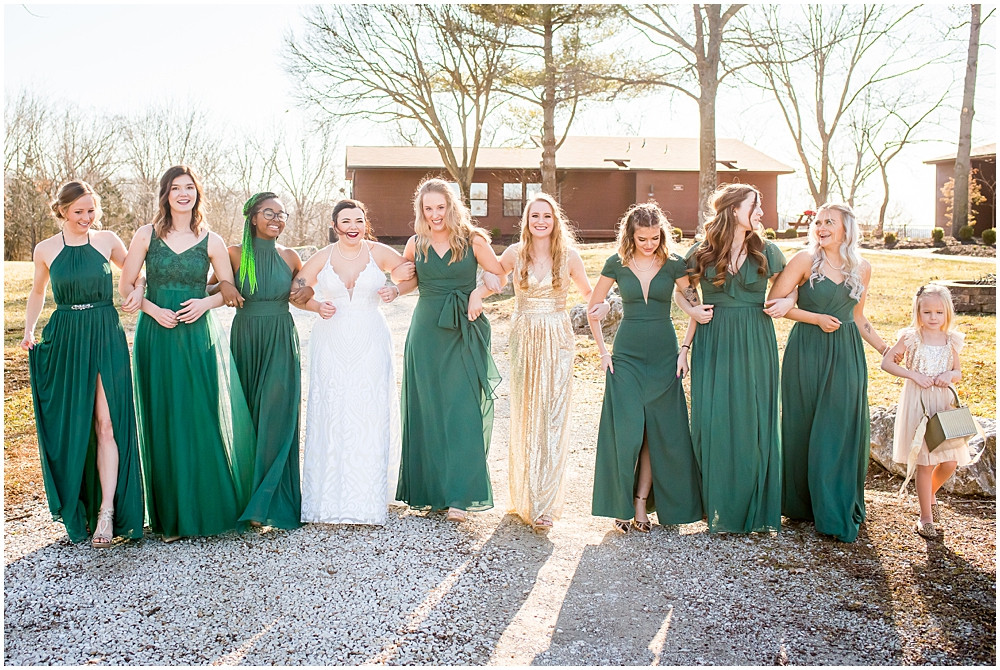 bridesmaids in hunter green and gold dresses