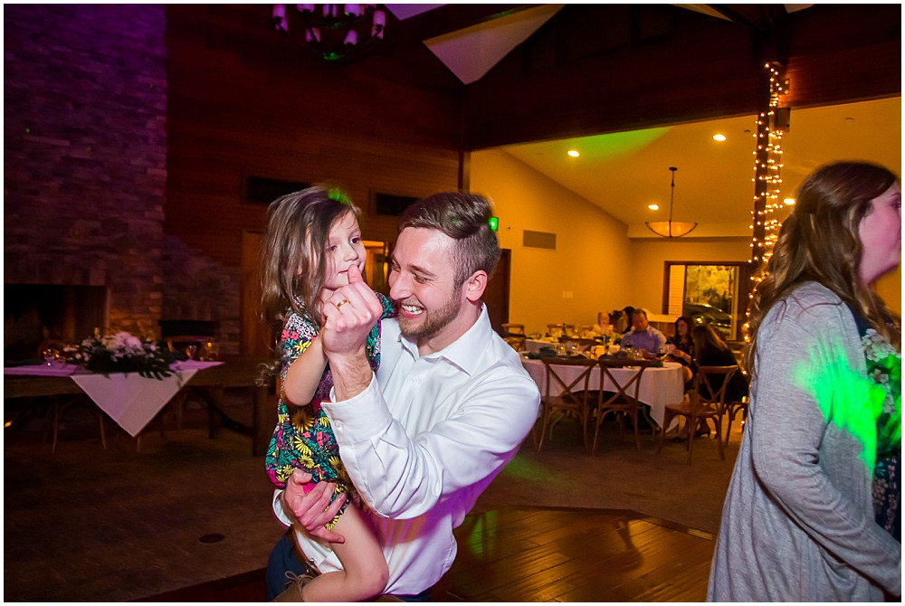 groom dancing with little girl