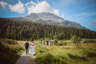 Hannah and Thomas Swiss wedding. Switzerland Wedding in Pontresina. Dream Wedding. Mountaintop wedding. Celerina chapel. Romantic international wedding. First glance at the Hotel Walther in Pontresina. Old timer car came to pick up the couple for their bridal portraits.