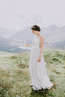Switzerland Wedding in Pontresina. Portrait of a bride. Mountains.