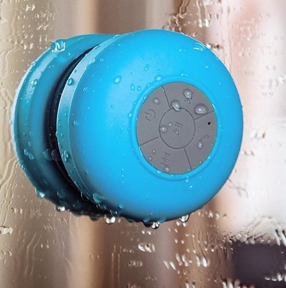 Waterproof Bluetooth Shower Speaker attached to glass