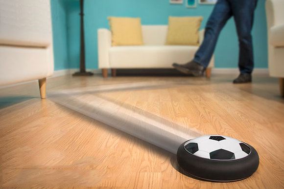 Hover Football kicked and bouncing off walls on laminate floor