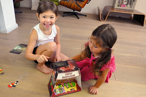 Children recording their own puppet show with the Mobile Theatre