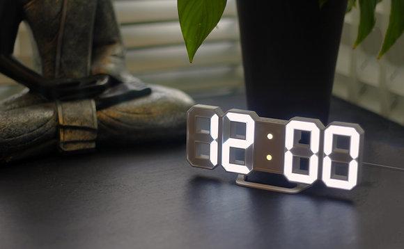Illuminating LED Borderless Clock at home on bedside table