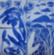 Contemporary hand-painted artistic tiles of a dreamscape in traditional blue and white glazes using etching techniques.