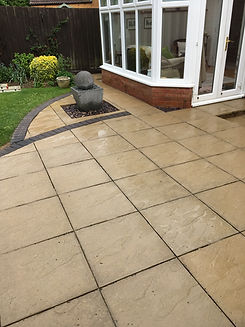 A cleaned patio black spot Lichen removal