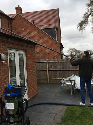 A person cleaning a gutter
