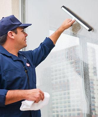 Man cleaning window.