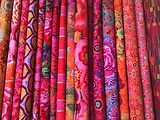 Bolts of fabric lined up in Country Threads quilting shop in Bath, UK