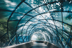 Structural glass facade curving roof and