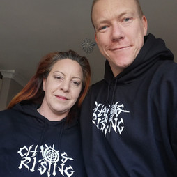 Wayne and Keziah wearing our CHAOS RISING hoodies!