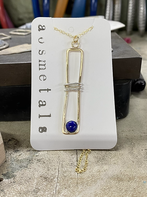 Organic form mixed metal necklace with Lapis