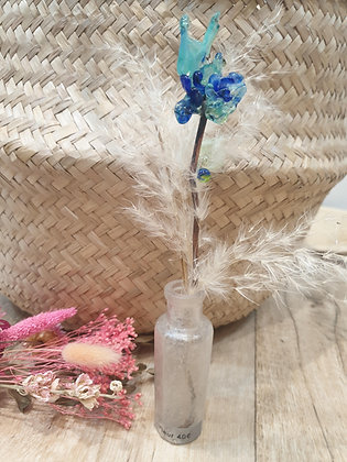 Vase et fleur en verre
