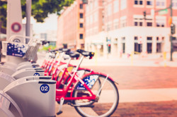 Row of red rental bikes parked at the re
