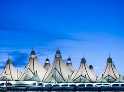 Glowing tents of DIA at sunrise