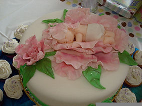 Sleeping baby shower cake Aaron Coulson ACEntertainment