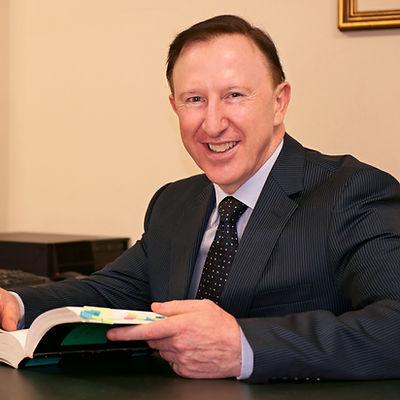 Mark Hanna at desk 8x10.jpg