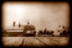 Photo of Grain Header in use | Goessel Museum