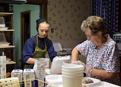 Volunteers make New Years cookies for Threshing Days