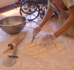 Cutting the dough.